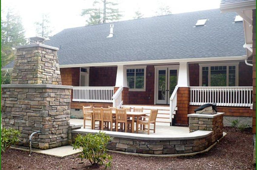 Back patio and deck with stone fireplace and grill